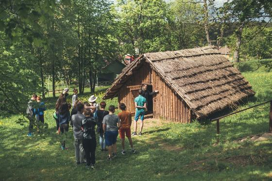 Burial mound exhibition and a Sone Age hut in Palūšė 3